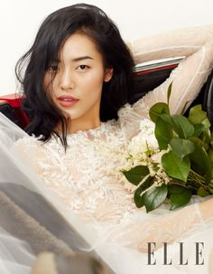 The Chinese model wears romantic styles including lace dresses