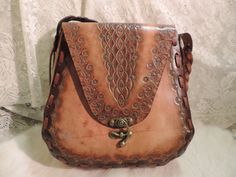 Hey, I found this really awesome Etsy listing at https://www.etsy.com/listing/179855862/meduim-leather-tooled-vintage-retro