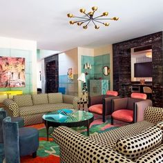A bold and colorful living room by Kelly Wearstler that is as playful as it is chic.