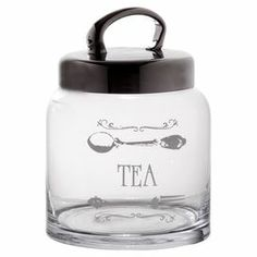 "Keep your kitchen organized with this glass canister, perfect for storing tea bags or essential ingredients.   Product: CanisterConstruction Material: Glass and metalColor: ClearFeatures: 33 Ounce capacityDimensions: 7.75"" H x 5.1"" Diameter"