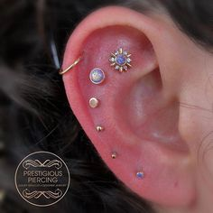 Sometimes, you just go all out and get your ear dripping in gold for your bday ✨ thank you to my sweet client Geraldi for having me do this piercing project for her birthday. Whole ear is rose gold by Leroi ✨It warms my heart when I get to be apart of Cute Ear Piercings, Multiple Ear Piercings, Tragus Piercings, Body Piercings, Piercing Tattoo, Tattoo Ink, Lip Piercing, Garnet Earrings, Cuff Earrings