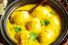 Turmeric gives a golden gloss to hard-boiled eggs in this fantastic coconut-based curry.