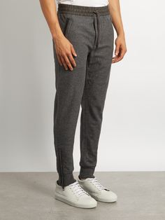 BURBERRY  Leather-trimmed wool-blend track pants €317