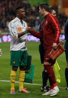 Portugal's Cristiano Ronaldo, right, shakes hands with Cameroon's Samuel Eto'o before their friendly soccer match Wednesday, March 5 2014, in Leiria, Portugal. The game is part of both teams' preparation for the World Cup in Brazil