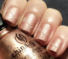 Subtle stamped roses. Love that this is rose gold and nude, a work manicure with a twist.