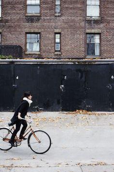 all black while riding bikes//