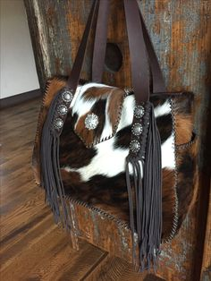 """An extra large Bonnie Bag at 15 1/2"""" wide by 11 1/2"""" high and 6"""" deep. This one has the exterior side pockets lined in suede, straps with side fringe and a Swarovski crystal concho on the flap. gowestdesigns.us"""