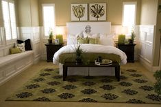 Stunning green highlights the rug, mattress, lamps and pillows in this master bedroom.
