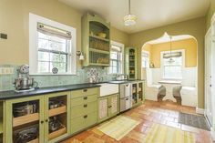 Country Kitchen with Glass panel, Inset cabinets, Built-in breakfast nook, Farmhouse sink, Flush, Plate rack, One-wall