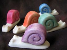 Many magical creatures live at Syrendell! This listing is for our friend, snail. Snail is lovingly crafted by hand out of poplar wood, with the shell