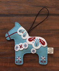 Nikkie's Felt Dala Horse Christmas Ornament- Light Turquoise You can hang this Felt Dala Horse Ornament on your Christmas tree, room mirror in your car and beautifully decorate your home in your special way. Also, it is going to be a perfect Horse Christmas Ornament, Felt Christmas Decorations, Felt Christmas Ornaments, Diy Ornaments, Beaded Ornaments, Felt Ornaments Patterns, Christmas Nativity, Christmas Stocking, Swedish Christmas