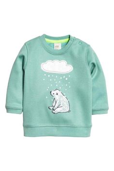 Printed sweatshirt: Long-sleeved top in soft, marled sweatshirt fabric with a print motif, press-studs on one shoulder and ribbing at the cuffs and hem. Baby Outfits, Kids Outfits, Printed Sweatshirts, Hoodies, Kids Fashion Boy, H&m Online, Knitting For Kids, Baby Sewing, Online Shopping Clothes