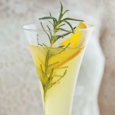 SPARKLING RUM PUNCH: 2 cups fresh orange juice; 1/2 cup orange liqueur; 1/2 cup dark rum; 2  bottles sparkling wine, chilled. Stir together orange juice, orange liqueur, and rum in a medium bowl; cover and chill 1 hour. Pour mixture into a large pitcher or punch bowl, and top with chilled sparkling wine. Serve immediately.