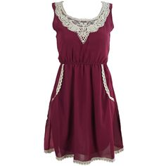 Pretty Red Sleeveless, Scoop-neck dress with pretty lace detail at the neckline and pocket trim.