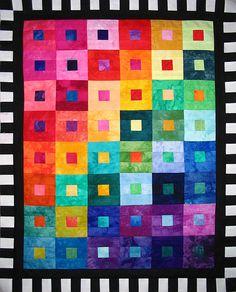 Bright quilt:  love the black & white border
