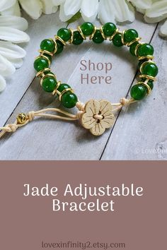 This Boho Green Jade adjustable bracelet is made with green jade gemstone beads and features a dainty coconut Sakura flower button. Waxed cord adjustable closure.  The Sakura flower symbolizes the beauty of nature, renewal, and hope.  In Feng Shui, jade is known for harmony, balance, protection and for good luck. It is said to bless whatever it touches bringing love, wealth, prosperity, and abundance. #jade #prosperity #renewal #fengshui #sakura #adjustable #gemstone Creative Gifts, Creative Ideas, Feng Shui Jewellery, Good Luck Bracelet, Bracelets With Meaning, Flower Button, Boho Green, Jade Bracelet, Baby Girl Gifts