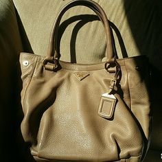 Prada Cervo Hobo (Taupe) NO LOW BALL offers or trades please. *See additional pictures of the bag in my closet. Soft cervo leather handbag. Sides have 2-tone zipper detailing. All brass hardware. In a very small area on back of purse (pictured) has slight discoloration-can't be seen when wearing. Handles have patina, which is normal for any bag. Inside is perfect :) Beautiful bag with many years left. No authenticity cards but I do have the dustbag. POSH will verify authenticity for free…