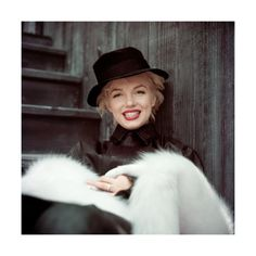 Marilyn. Black coat sitting. Photo by Milton Greene, 1956.