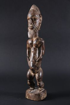 AFRICAN FIGURE - Baule People, Ivory Coast, Husband Spirit Spouse or 'Blolo Bian' in carved wood, with elaborate coiffure, beard, scarification on torso, on integral base. 19th to 20th c.