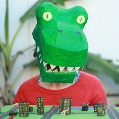 Make this T-rex head using a construction hard hat, paper mache, and a bit of cardboard!