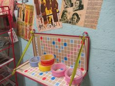 Re-purposed Scrabble board shelf...{The Paper Collage Store}