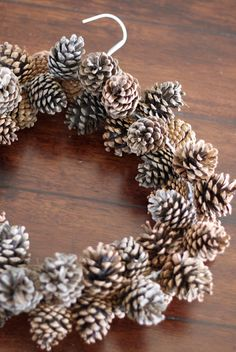 do it yourself divas: DIY: Pinecone Wreath (Practically FREE) Very ingenious!Zrób to sam Divas: DIY: Pinecone Wieniec (praktycznie wolne)DIY: Pinecone Wreath (using a wire hanger and pony beads)diy pinecone wreath great for the winter! Christmas Wreaths, Christmas Bulbs, Christmas Decorations, Diy Christmas, Christmas Projects, Christmas Ornament, Pine Cone Crafts, Holiday Crafts, Holiday Ideas