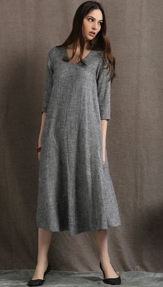 Playful and polished all at once, this simple gray linen dress certainly packs a punch in the versatility stakes. With a V-neck and 3/4 length sleeves,