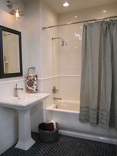 Subway tile, octagon floor tile   Imperial Bone- I love the shower curtain, it's from Pottery Barn
