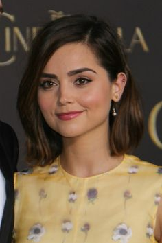 Jenna Coleman Long Bob with Loose Waves How To Style: Apply a product to create some grit and texture on wet hair. Power dry the hair. Wrap sections of hair from the midshaft to the ends loosely around a large curling wand in random directions, leaving the hair close to the roots straight. Tuck the hair on one side of the head behind the ear. Scrunch and rough up the hair with fingers and a product for texture to make the waves look more organic. Set with flexible hold finishing spray.