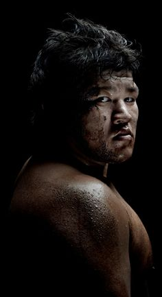 Portrait of Sumo wrestlers.  Photography by Denis Rouvre