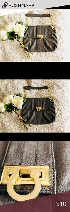 """Avon mark mighty mini bag 💼 Like brand new condition. Used. Gold hardware has some sign of use but can not tell in person unless you are looking up close.  Gray Faux Leather Goldtone hardware 12"""" L x 1 3/4"""" W x 9 1/2"""" H  7 1/2"""" handle drop Inside: 1 zip pocket and 2 slide pockets & gray lining  Comes from a smoke/pet free home Ship 🚢 same day with very careful and crafty packaging plus extra goodies 😉 Avon Bags Shoulder Bags"""