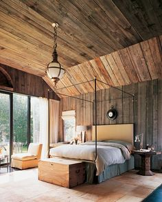 Dream of a wood, log cabin home, filled with cathedral ceilings, vaulted angles, wides spaces. This bedroom is beyond fabulous with the simple decor, the boldness of the light fixture & angle textured ceiling & walls is enough to take your breath away in this bedroom.