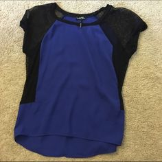 Super cute blue and mesh shirt This shirt is blue shear and black mesh leaving the sides see through. Super cute shirt I am just too tall for it Tops