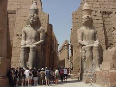 Luxor temple entrance pylon, the obelisk and the colossal statues of King Ramses II in front of the pylon; http://www.travel2egypt.org/tours/cairo-aswan-luxor/unforgettable-egypt-8422_87/