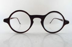 962592c1a1 Late - early tortoise shell effect glasses frames with round lens surrounds  and keyhole shaped bridge.