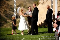 Retro 1950s inspired wedding ceremony at Louland Falls, Utah.  Black, white and red wedding colors.