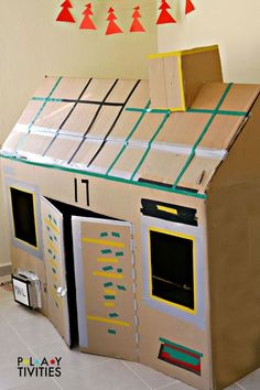 How To Build The Most Simple Cardboard House - PLAYTIVITIES - - How To Build The Most Simple Cardboard House from just 1 cardboard box. Kids will play in this cardboard box for hours! Cardboard Box Fort, Cardboard Houses For Kids, Cardboard Box Crafts, Cardboard Box Ideas For Kids, Cardboard Tubes, Cardboard Furniture, Playhouse Furniture, Diy For Kids, Crafts For Kids