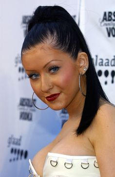 Slicking back your hair with gel to achieve the sleekest of high ponytails. Side Ponytails, Ponytail Styles, Hair Styles, Christina Aguilera, Butterfly Hair, Hair Hacks, Her Hair, Hair Clips, Hoop Earrings