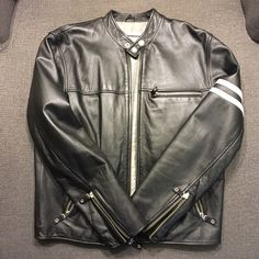 Wilsons Leather Motorcycle Jacket Black leather motorcycle jacket with two white arm bands on left sleeve. Wilsons Leather Jackets & Coats