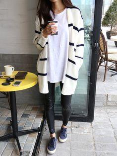 Cozy coffee run with an oversized striped cardigan.
