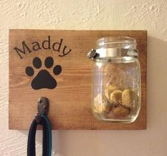 Dog Leash/Dog Treat Holder/Mason Jar- Personalized- Dog/Pet Lover Gift This mounted mason jar and hook holder (for dog leash or keys!) is a great addition to any household with a pet (cats included!). It is made out of solid wood that is stained. If you are interested in a darker