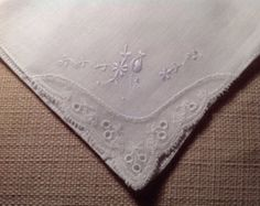 A pretty vintage handkerchief, very fine and delicate. An ideal accessory or gift for anyone, but particularly nice for special occasions. Lovely for a bride, bridesmaid or one of the ladies in the bridal party maybe. With fantastic delicate white embroidery and cut out work. Freshly laundered and in great condition with no marks or damage.