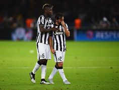 Andrea Pirlo of Juventus is consoled by Paul Pogba after the UEFA Champions League Final between Juventus and FC Barcelona at Olympiastadion on June 6, 2015 in Berlin, Germany.