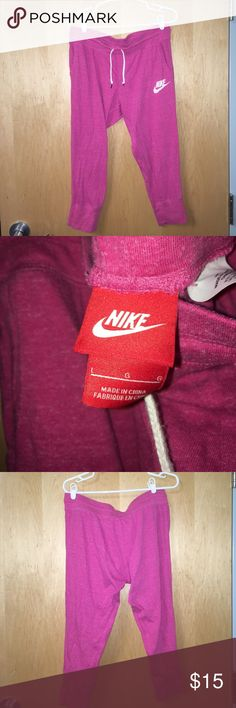 """Pink NIKE cropped sweatpants Super soft heather pink lounge pants with pockets. Slightly cropped, I'm 5'9"""" and they fall in the middle between my knee and ankle. Looser fit, tighter at the end of each leg. Gently worn with slight natural pilling on inside of waist band. No flaws or noticeable pilling. 😊 first three pictures were taken with flash. Photo of the nike logo most accurately shows the color. (Size L but I am a size M and they fit perfectly as well) Nike Pants Ankle & Cropped"""