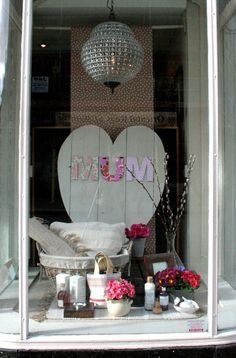 where America saves Salon Window Display, Window Display Retail, Merchandising Displays, Store Displays, Retail Displays, Decoration Vitrine, Shop Front Design, Happy Mothers Day, Ladder Decor