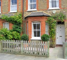 Terraced front garden in Twickenham I like the 2 tree and the trellis above the door - which would look nice with a flower plant growing up it