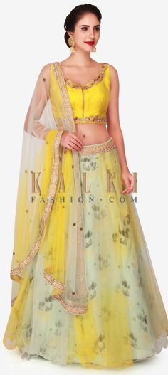 Buy Online from the link below. We ship worldwide (Free Shipping over US$100)  Click Anywhere to Tag Yellow lehenga in net with mint blue blouse adorn in moti and zari embroidery work only on Kalki For your engagement night or a pre-wedding dinner, opt for the latest 'must-have' colour - yellow! The lehenga in net has an underlined in tissue with floral prints is decorated with moti and zari work at the waist. The blouse in mustard yellow is designed using combination of french-knots…