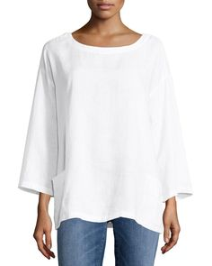 Eileen Fisher tunic in lightweight, organic woven handkerchief linenyour choice of color. Banded bateau neckline; button placket behind neck. Three-quarter, drop-shoulder sleeves. Patch pockets at hip