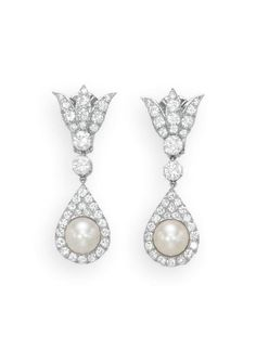 A PAIR OF CULTURED PEARL AND DIAMOND EAR PENDANTS   Each suspending a cultured pearl, measuring approximately 9.00 mm, within a diamond tear-drop surround to the diamond link and circular-cut diamond trefoil surmount, mounted in platinum