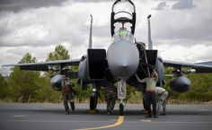 Aircrew from the 494th Fighter Squadron and members of the 494th Aircraft Maintenance Squadron inspect an F-15E Strike Eagle prior to a sortie in support of Tactical Leadership Programme 16-3 at Los Llanos Air Base, Spain Sept. 14, 2016. Training programs like the TLP showcase how the U.S. works side-by-side with NATO Allies and partners every day training to meet future security challenges as a unified force. (U.S. Air Force photo/ Staff Sgt. Emerson Nuñez)